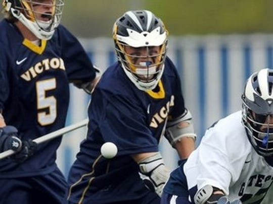 In this file photo from 2011, Alex Davis is shown playing lacrosse for Victor High School.