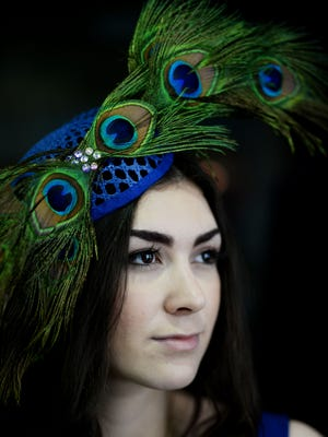 Taylor Teach wears a hat by Jane Ryder Millinery from the Harper House Boutique.