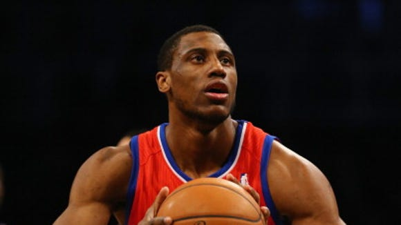 Thaddeus Young (21) of the Philadelphia 76ers in action against the Brooklyn Nets  during their game at the Barclays Center on December 16, 2013 in the Brooklyn borough of New York City. NOTE TO USER: User expressly acknowledges and agrees that, by downloading and or using this photograph, User is consenting to the terms and conditions of the Getty Images License Agreement.