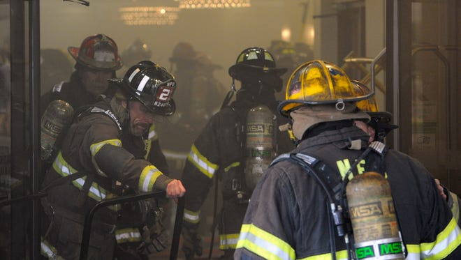 Nashville firefighters make their way into the lobby of the Holiday Inn Express as they battle a two-alarm fire at the hotel on Broadway on Monday, May 11, 2015, in Nashville.
