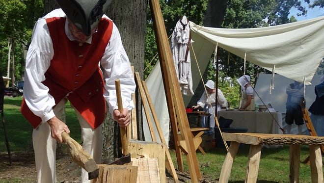 Kevin Wappner demonstrates historical construction techniques during Living History Days.