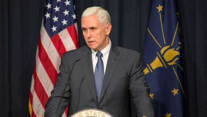 Mike Pence, Indiana Governor, speaks to press members following his signing of the state's Religious Freedom Restoration Act, Thursday, March 26, 2015.