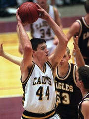 1999: Iowa Falls' Nick Collison (44) is defended by