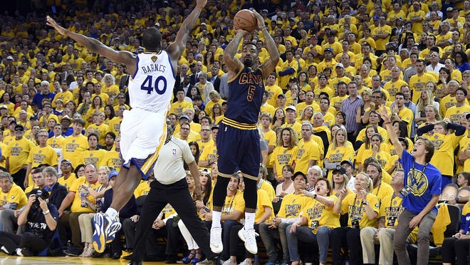 Jun 7, 2015; Oakland, CA, USA; Cleveland Cavaliers guard J.R. Smith (5) shoots the ball over Golden State Warriors forward Harrison Barnes (40) during overtime in game two of the NBA Finals at Oracle Arena. Mandatory Credit: Kyle Terada-USA TODAY Sports