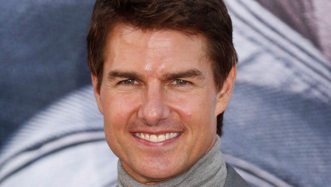 Tom Cruise wrote in a sworn declaration filed Tuesday, Nov. 5, 2013, in a defamation lawsuit against Bauer Publishing Co. that he maintains a close relationship with his daughter Suri.