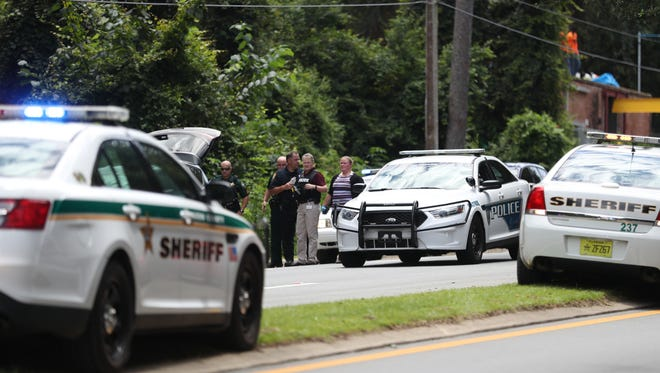Leon County Sherriff's Officers respond to a scene on Blair Stone Road on Wednesday afternoon in which a man is accused of stealing two chainsaws and fleeing police.