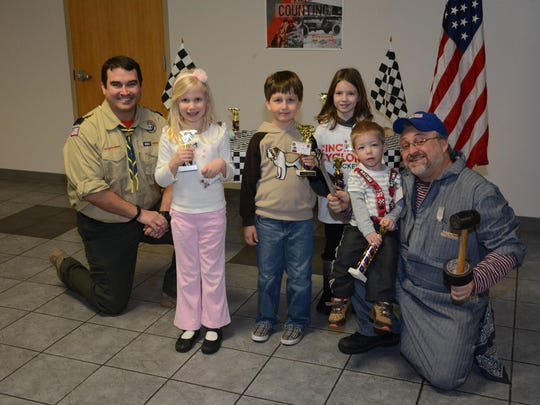 Mary Keller, Gabriel Brown, Ayla Luzak and Roman Vykhovanyuk received a trophy at Pinewood Derby.