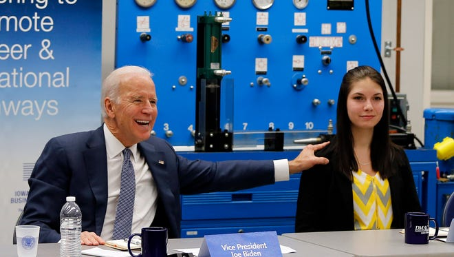 Vice President Joe Biden speaks about welding student Heather Haag, right, as he conducts a round table discussion on jobs at the DMACC campus in Ankeny Thursday, Feb. 12, 2015.
