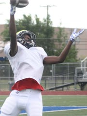 Thurston receiver Nick Carey elevates for a one-handed