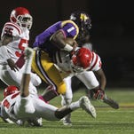 Three Ruston players combine to tackle a Wossman player last week.