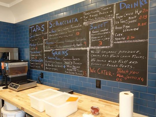 The chalkboard menu at Pa'La.