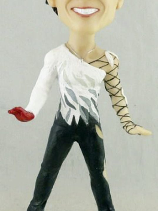 Pictured is the Johnny Weir bobble head that will be given away Friday night.