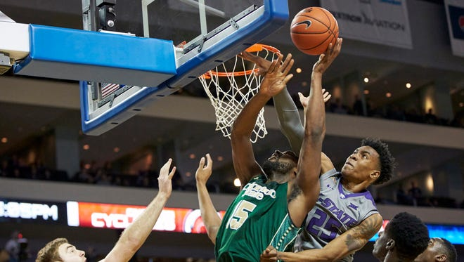 CSU's Tiel Daniels tries to get a shot to the rim while battling Kansas State's Wesley Iwundu during Saturday's game  in Wichita, Kansas. The Wildcats bet the Rams 61-56.
