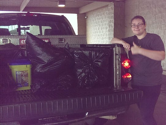 Lindsay Esser, 18, helps with donations for the victims