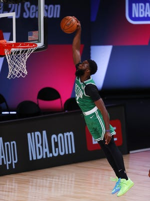 The Celtics' Jaylen Brown, who had a big fourth quarter against the Portland Trail Blazers Sunday afternoon, dunks the ball at The Arena in Lake Buena Vista, Fla.
