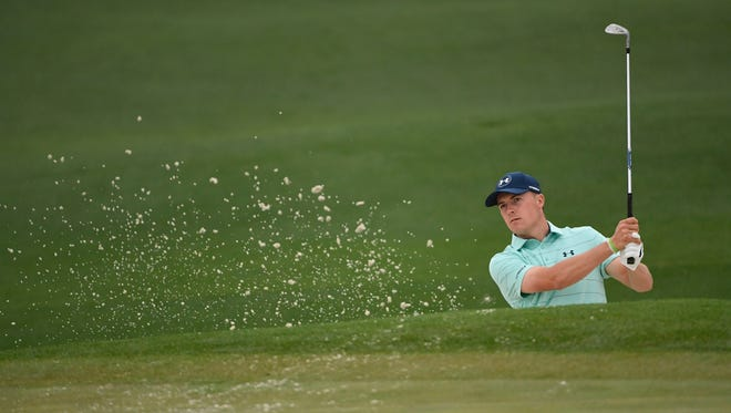 Jordan Spieth hits from a bunker on the 2nd hole during a practice round at Augusta National Golf Club.