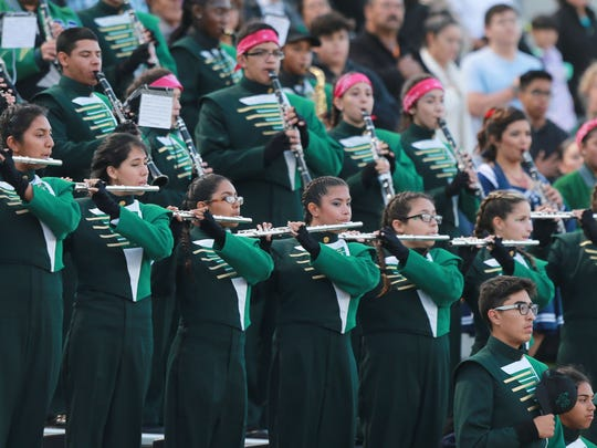 The Montwood High School band performs during a football game. File art.