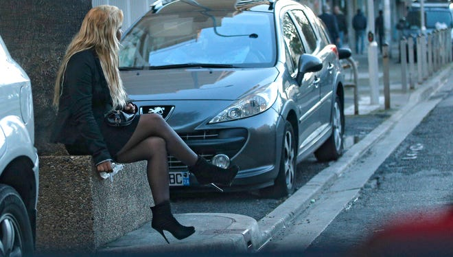 A prostitute waits for a client on a street in Nice, France, on Nov 21.