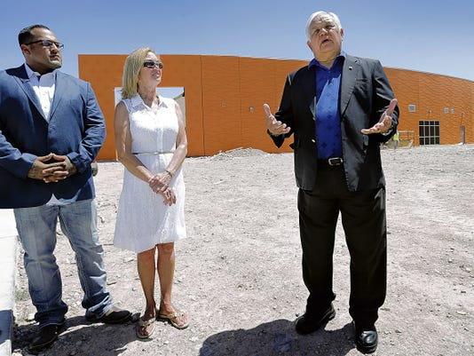 Former U.S. Rep. Silvestre Reyes talks about the effort to raise 50,000 to repaint the flag mural at the Congressman Silvestre and Carolina Reyes Elementary School. Canutillo Independent School District board president Laure Searls is at left with veteran Vince Vargas.