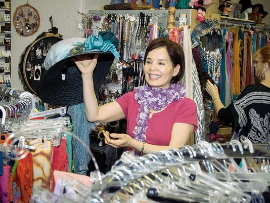 Jett Loe - Sun-News Esther Patterson, at left, shops for clothing on her first visit to the My Place Jewell studio and store in April.