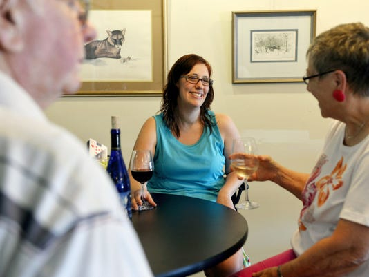 From left, Raymond King of York Township, Traci Rodkey of Dallastown and Karen Snyder of York Township catch up over a bottle of wine at the opening of Allegro Winery's wine bar location in the Olde Tollgate Village shopping center in York Township. The location was formerly a retail tasting room but is now a wine bar featuring sample flights of wine to be served with crackers and cheese.