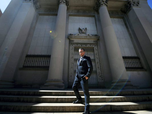 """John McElligott stands in front of what will be """"The Fortress,"""" formerly the  Western National Bank Building on 301 W. Market St. in York on Wednesday. McElligott is opening a coding boot camp and tech startup accelerator."""
