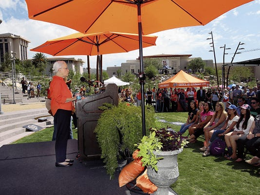 Under the shade of bright orange umbrellas at Centennial Plaza, UTEP President Diana Natalicio announces the school's top 10 ranking for 2015 among national universities by Washington Monthly magazine on Tuesday on campus.