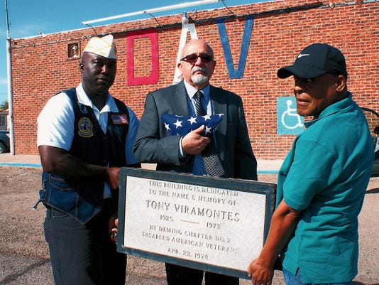 Bill Armendariz — Headlight Photo   New Mexico Disabled American Veterans Executive Officer Reggie Price, left and Sam R. Jones Jr., readjustment counseling technician, right, presented the cornerstone of the condemned DAV Hall to the Honorable Judge Daniel Viramontes. The hall and the DAV Chapter 2 is named in memory of his father, Tony Virmaontes, a WWII veteran, charter DAV member and local farmer.