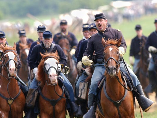 7/4/2004 JASON PLOTKIN — Daily Record / Sunday News  Members of a Union cavalry division advance during a battle reenactment Saturday near Gettysburg. On the battlefield itself, where reenactments aren't allowed, a group of around 160 people who attended a morning battle walk got a closer look at the ground the cavalry fought over 141 years ago Saturday. The cavalry attack July 3, 1863, on the southern end of the battlefield ended in disaster for the blue horsemen.   *************************************  Saturday's Civil War Reenactment included a cavalry demonstration. Daily Record/Sunday News-Jason Plotkin