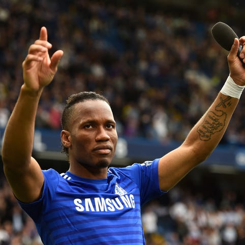 Didier Drogba celebrates winning the Premier League title with Chelsea this past season.
