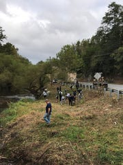 Volunteers clean up the Scotland streamside on Saturday,