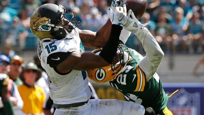 Jacksonville Jaguars wide receiver Allen Robinson (15) has his pass broken up by Green Bay Packers cornerback Damarious Randall (23) at Everbank Field.