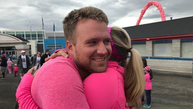 Brett Rowan of Reno hugs mom Cindy Lain before the annual Moms on the Run race on may 13, 2018.
