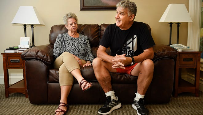 Jan Hills and Stephen Pay, Sussex Inlet, Australia, talk Friday, July 21, about Steve's quadruple bypass surgery at the St. Cloud Hospital. Their trip across the country on a motorcycle was interrupted by a heart attack, open-heart surgery and quadruple-bypass.
