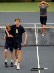 Brookfield Academy's Liam Matthews and Tayte Matthews walks off the court after defeating Xavier in the Division 2 doubles championship match at the 2018 WIAA boys tennis state tournament at Nielsen Tennis Stadium on Saturday, June 2, 2018 in Madison, Wis. 