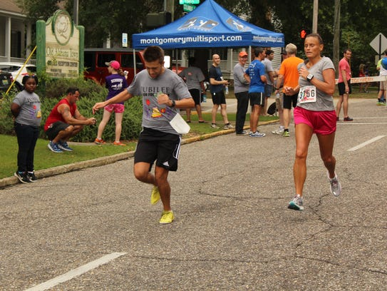 Adam Brett, left, and Kelly Rhodes, lead a group of