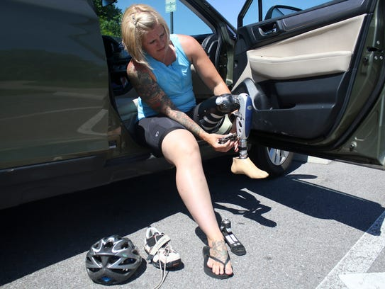 Sabrina Reiswig changes her prosthetic foot to her