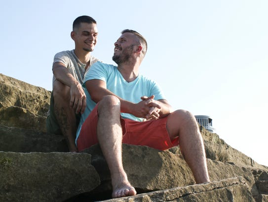Michael VanZant, left, and his husband, Travis, sit
