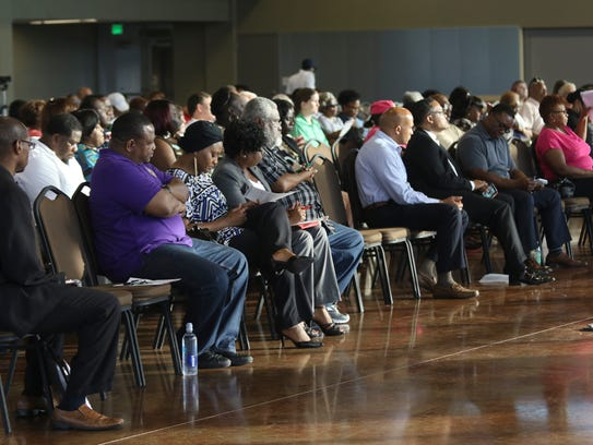 People listen during a race relations and policing