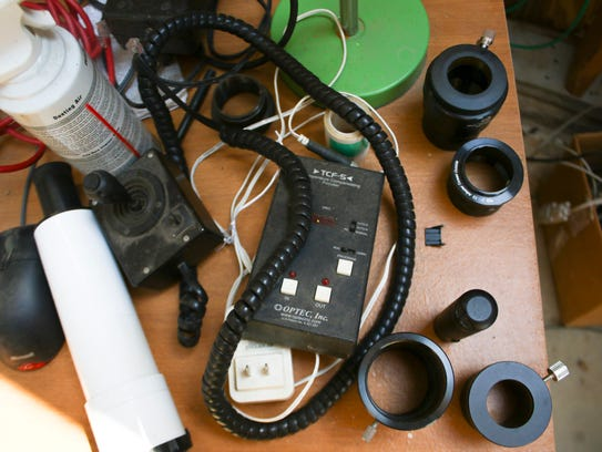 Various pieces of equipment and gear lie on a desk