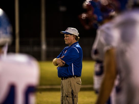 Harpeth coach Doug Loope watches his team warm up before