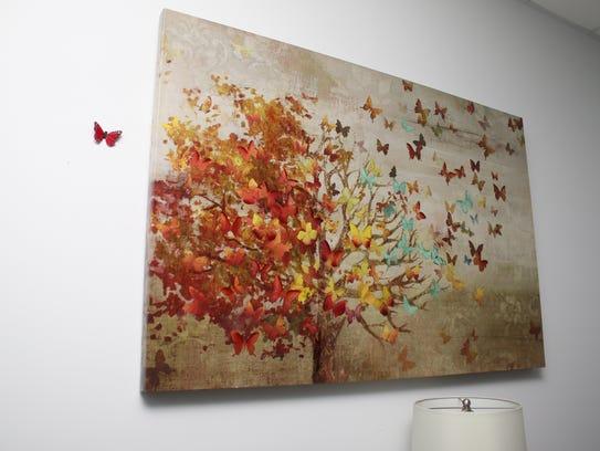 Random butterflies, symbolizing life, adorn AseraCare.