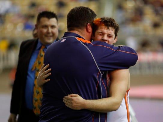 Blackman's Matthew Sells hugs his father, Matt Sells,