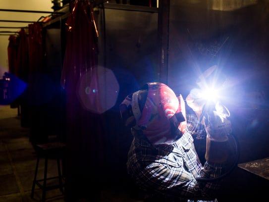 William Wallace welds inside the Moore Tech welding