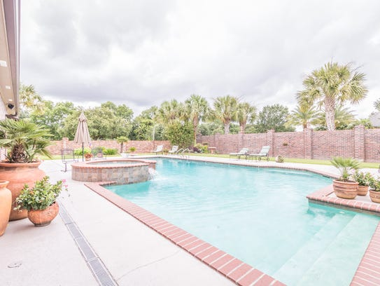 The beautiful pool area is large enough for any gathering.