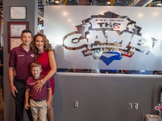 Marci Dickerson poses with her sons, Weston and Saxon,