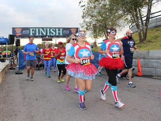 Runners start Saturday's Super Hero 5K race as part