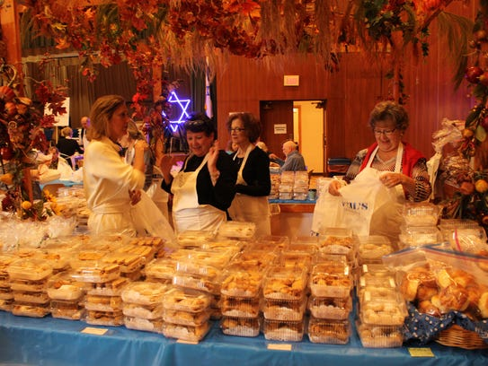 Volunteers prepare hundreds of pastry items prior to