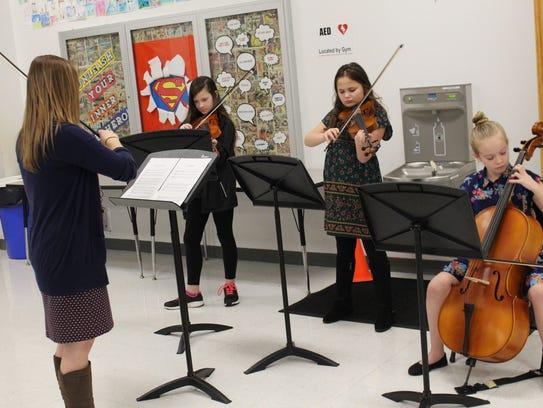 Instrumental teacher Kelly Backus pictured Left to