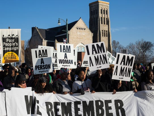 Activists seeking a higher minimum wage march from Clayborn Temple to Memphis City Hall on Feb. 12, following the same route taken by striking city sanitation workers 50 years before.